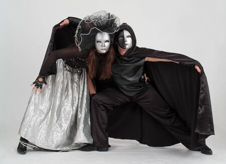 Young dancers in costumes and masks on a gray background Stock Photo - 4563046