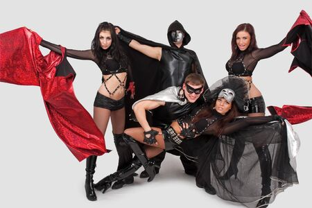 Young dancers in costumes and masks on a gray background Stock Photo - 4563049