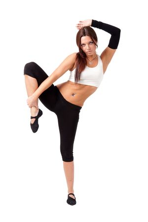 Young beautiful woman standing in yoga position, isolated on white background. photo