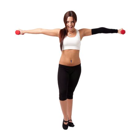 sportswoman: Attractive young woman exercising with dumbbells, isolated on white background