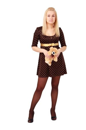 Attractive girl with toy bear  standing against isolated white background photo