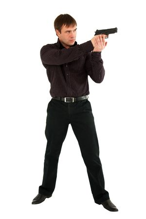 serious man with a gun standing against isolated white background Stock Photo