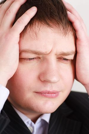 banging: Crisis. Stressed young business man close up.