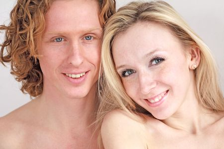 Portrait of attractive smiling couple close up photo