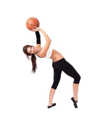 Young sportswoman with basketball, isolated on white background. photo