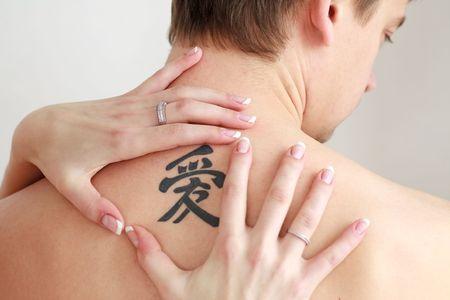 sexy tattoo: Mens back with a big tattoo close up