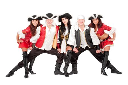Young dancers in pirate costumes standing against isolated white background