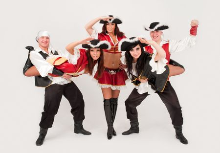 dancers in pirate costumes dancing on a gray background photo