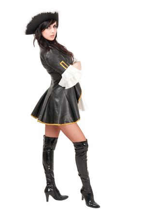 Attractive girl in a pirate costume and hat standing against isolated white background Stock Photo - 4994734