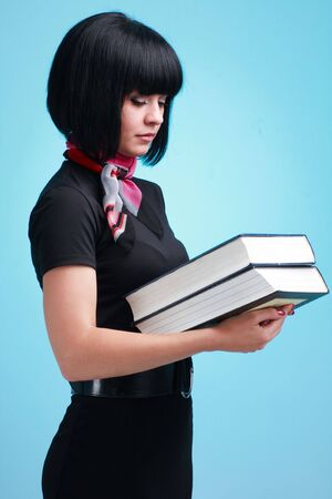 Student with big books on a blue background Stock Photo - 5107458