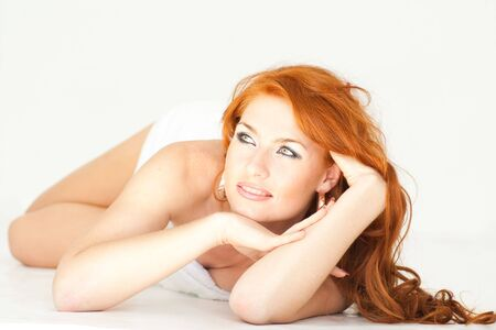 beautiful red haired woman with towel lies on a white background Stock Photo - 5153627