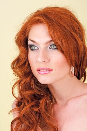 Beautiful red haired woman on a yellow background Stock Photo - 5153641
