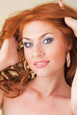 red haired woman: Close up portrait of beautiful red haired woman.