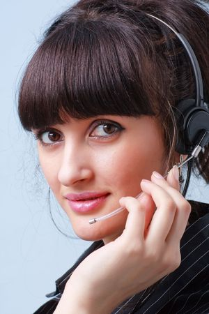 Customer services. Young attractive businesswoman with headset Stock Photo - 5176107