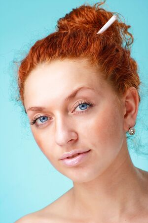 red haired woman: Beautiful red haired woman on a blue background Stock Photo