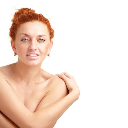 red haired woman: Attractive red haired woman close up on a white background with copyspace Stock Photo