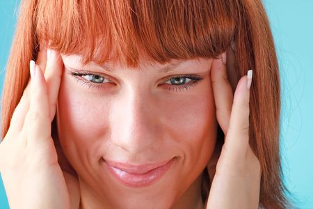 red haired woman: Beautiful red haired woman close up on a blue background
