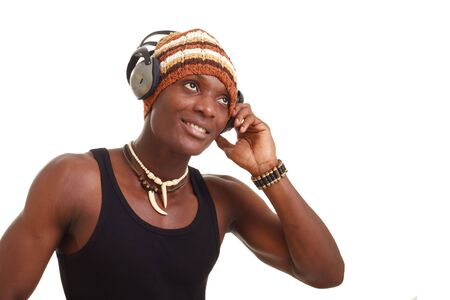 smiling young man with big headphones listening to music, isolated on a white background with copy space Stock Photo - 5284513