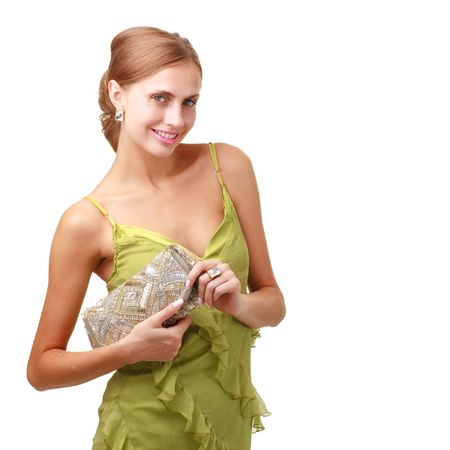Attractive young lady with handbag standing against isolated white background Stock Photo - 5305593