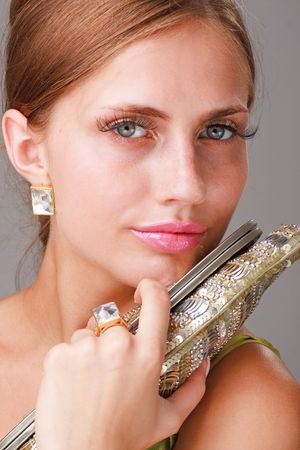 Attractive young lady with handbag close up Stock Photo - 5305601