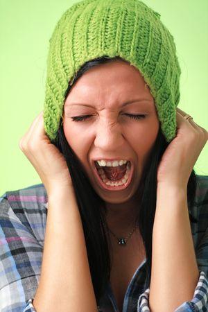 screaming woman in green woollen cap close up Stock Photo - 5305609