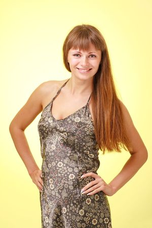 Attractive young lady on a yellow background. Stock Photo - 5338265