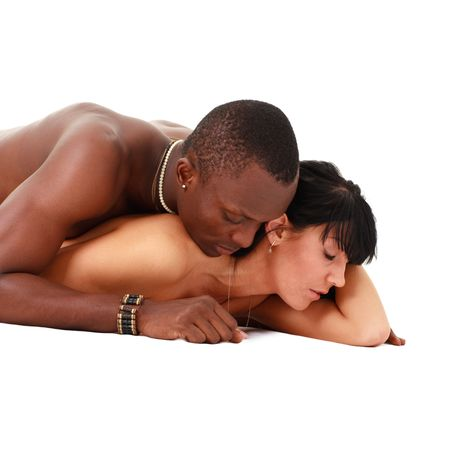 Young loving couple. White woman and black man lying on a white background