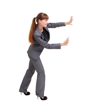 Business woman pushing something, isolated on a white background with copyspace Standard-Bild