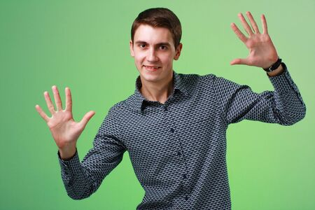 Happy smiling man on a green background photo