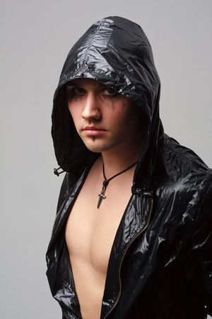 Portrait of a goth man on a grey background