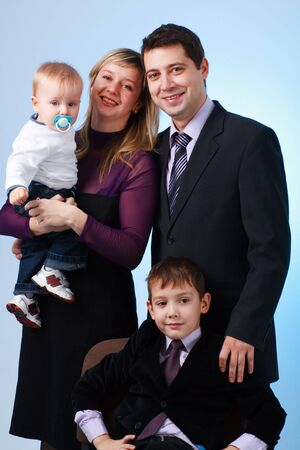 Happy smiling family on a blue background photo