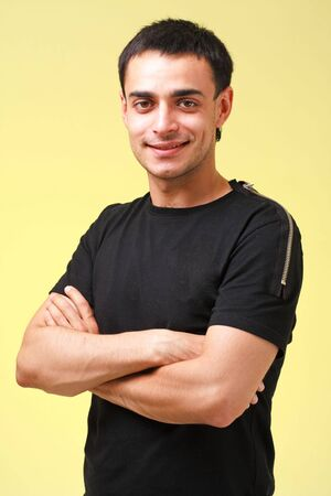 Attractive young man on a yellow background photo