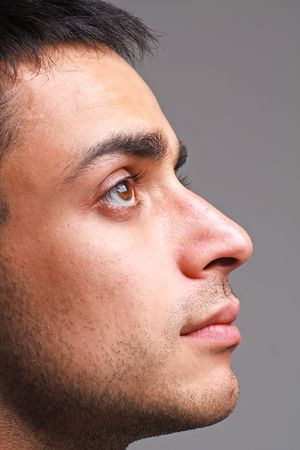 Profile portrait of young attractive man close up photo