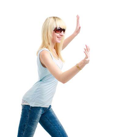 Attractive blond woman pushing something, on a white background with copyspace. photo