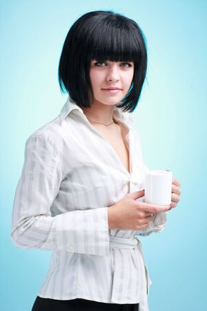 young woman with white cup on a blue background photo