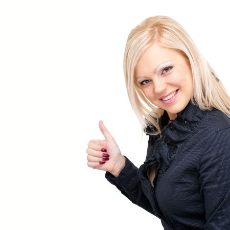 Smiling woman with thumbs up gesture. Isolated over white background, with copyspace. photo