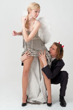 Temptation. Angel and devil on gray background Stock Photo - 6360326