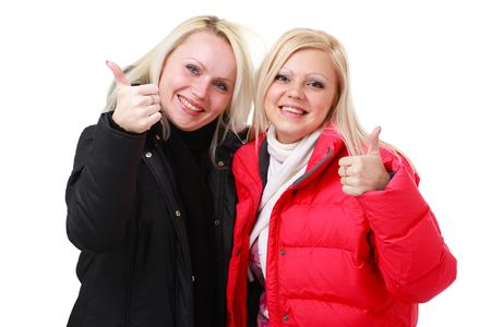 Two smiling women with thumbs up gesture. Isolated over white background, with copyspace. photo