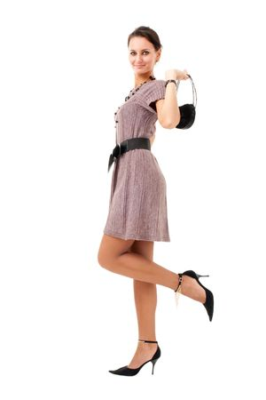 Attractive woman with purse standing on a white background