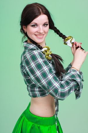 braided: Portrait of a girl with pigtails on a green background