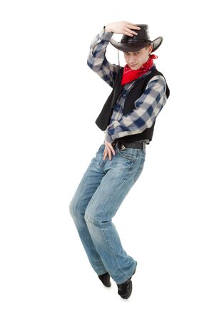 Young cowboy dancing on a white background photo