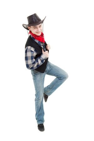 Smiling cowboy dancing on a white background Stock Photo - 6662120