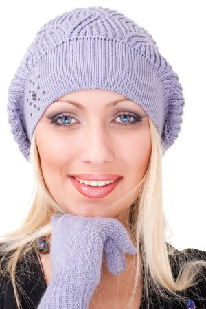 Smiling woman wearing a winter cap closeup