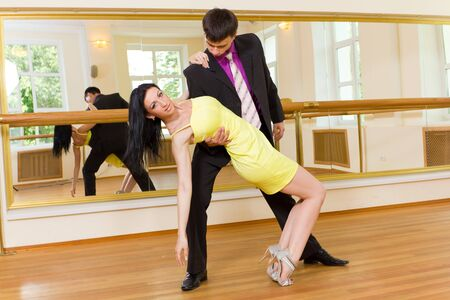 Young attractive couple dancing on the background of mirrors
