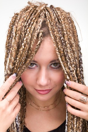 Closeup portrait of young beautiful woman with  dreadlocks. Stock Photo - 8020885