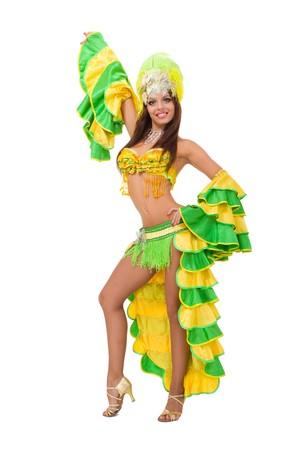 Beautiful carnival dancer posing against isolated white background Standard-Bild
