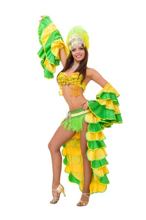 Beautiful carnival dancer posing against isolated white background Foto de archivo