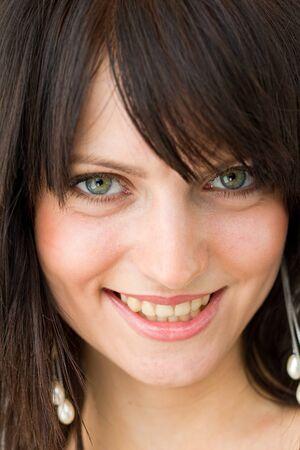 Closeup portrait of beautiful young smiling woman photo