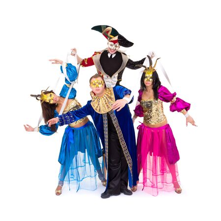 puppet theatre: Puppets. Dancers in carnival costumes posing on a white background Stock Photo