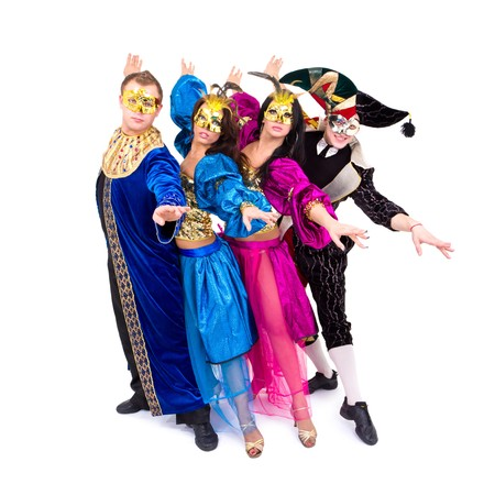 Dancers in carnival costumes posing on a white background
